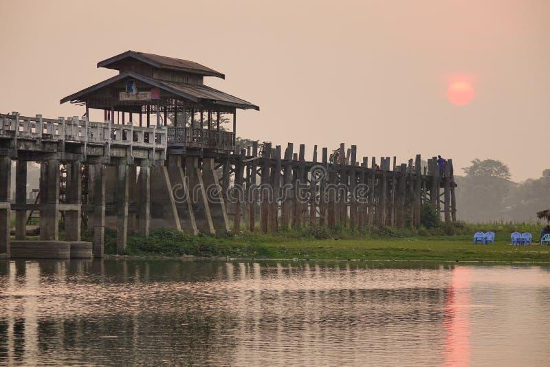 Ubein bridge at sunrise in Mandalay, Myanmar.  royalty free stock image