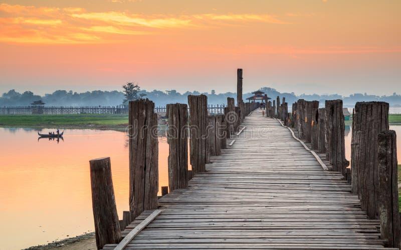 Ubein Bridge at sunrise, Mandalay, Myanmar. Ubein Bridge river at sunrise, Mandalay, Myanmar royalty free stock photo