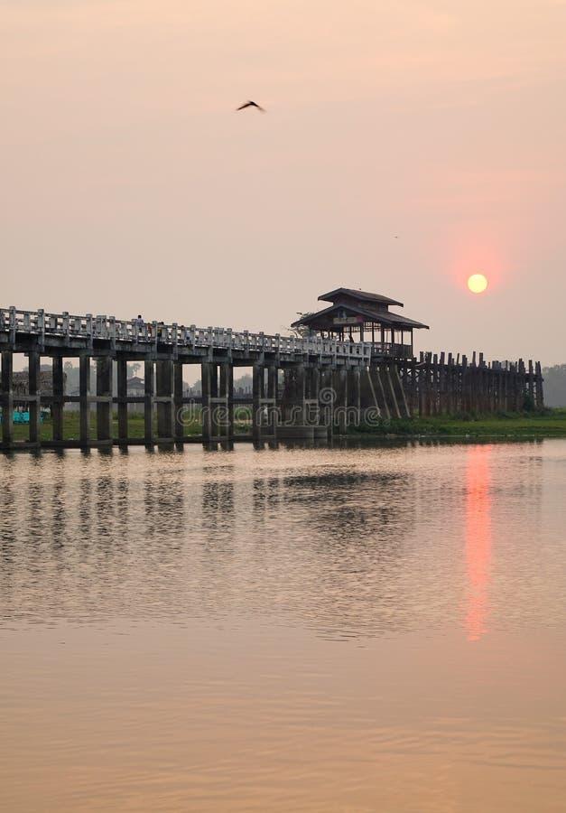 Ubein bridge at sunrise in Mandalay, Myanmar royalty free stock photo
