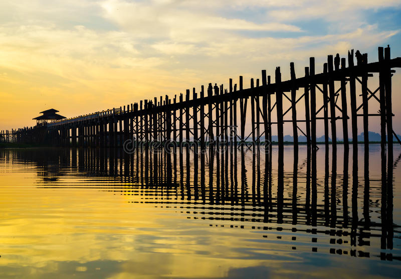 Ubein Bridge at sunrise, Mandalay, Myanmar. Ubein Bridge (world longest teak bridge) at sunrise, Mandalay, Myanmar stock photo