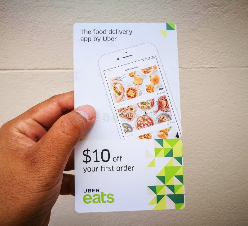 Uber吃$10的折扣证件在您的第一顺序 库存照片