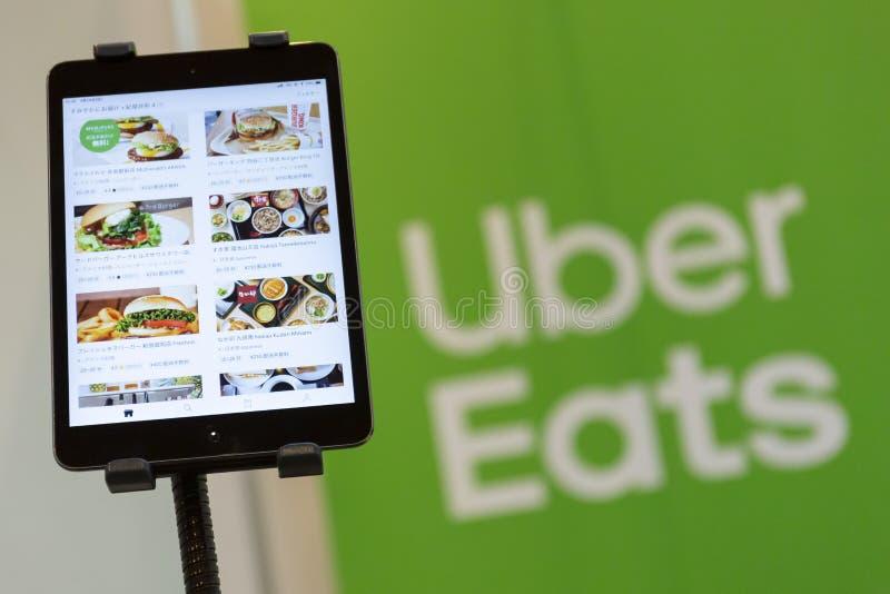 Uber äter appmenyn arkivfoton