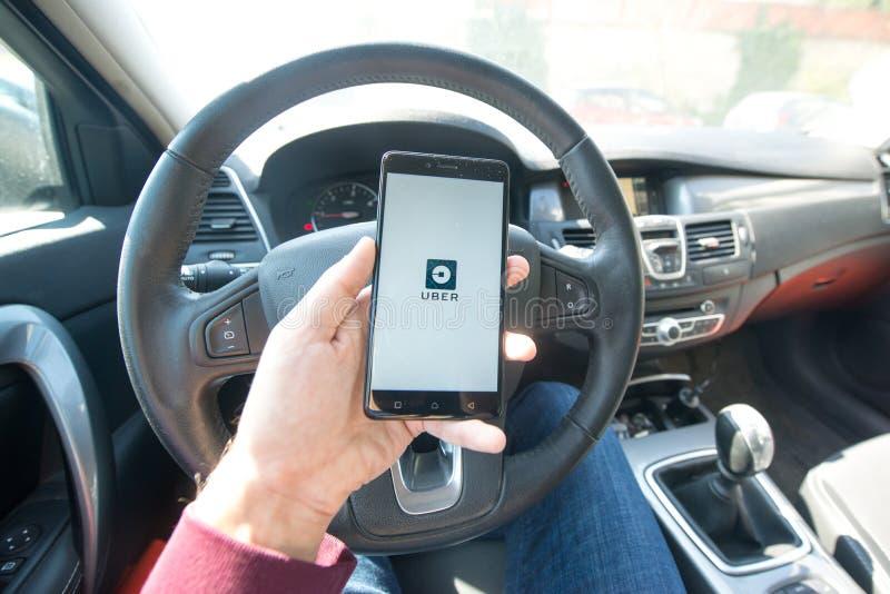 Uber applikation royaltyfria bilder
