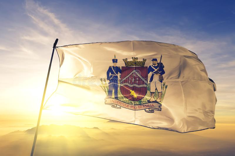 Uberaba of Brazil flag waving on the top sunrise mist fog. Uberaba of Brazil flag textile cloth fabric waving on the top sunrise mist fog royalty free stock photography