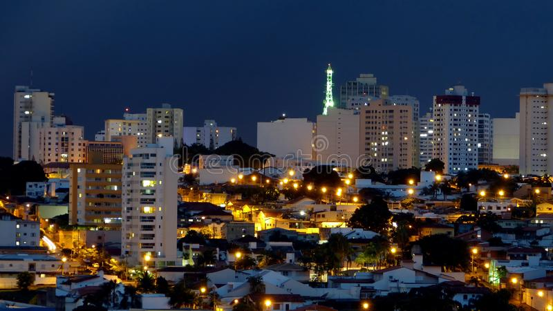 Night scene in a city in Brazil. Uberlandia, Brazil, during the early evening after rain stock image
