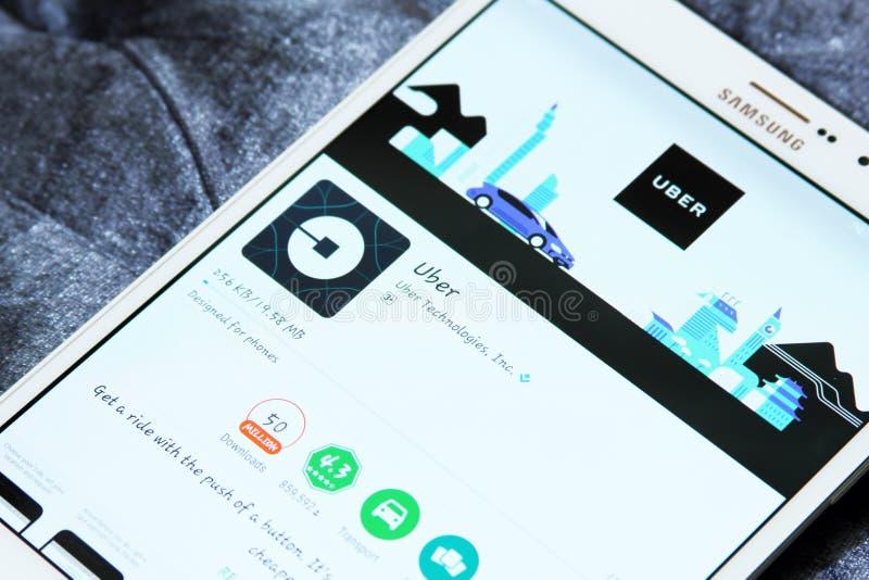 Ubertaxi app op googlespel stock afbeeldingen