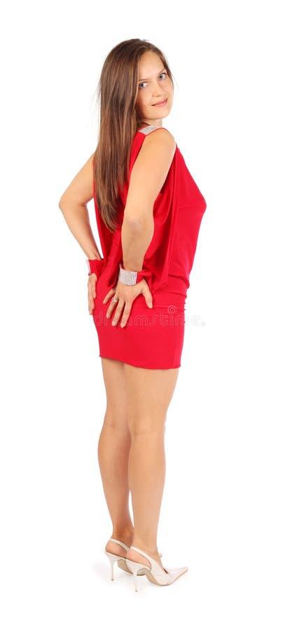 Ubierająca w sukni piękna kobieta przylega osioł zdjęcie stock