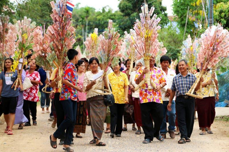 Ubonratchasima,THAILAND -March 13, 2014:offering robes to Buddhist priests at monastery. Ubonratchasima,THAILAND -March 13, 2014:offering robes to Buddhist stock images