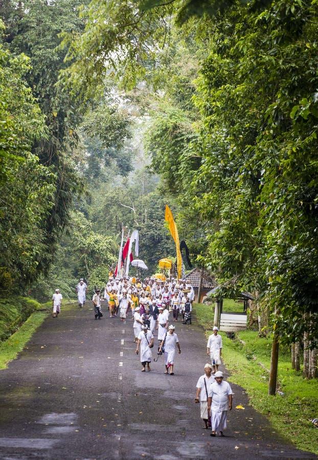 People celebrating a holly day near Ubud, Bali. Ubud, Bali, Indonesia – February 19: White dressed Hindu worshippers celebrating a holly day at a small stock photography