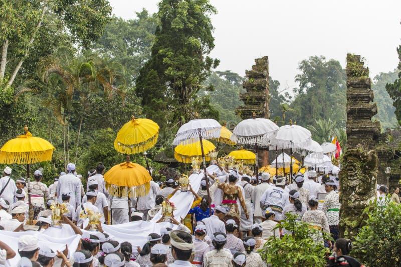 People celebrating a holly day near Ubud, Bali. Ubud, Bali, Indonesia – February 19: White dressed Hindu worshippers celebrating a holly day at a small stock images