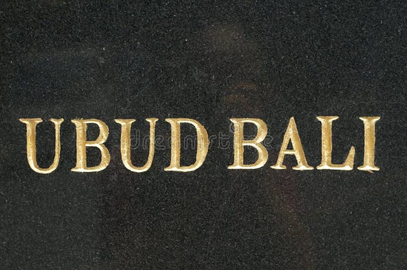 UBUD - BALI text on black marble slab stock photography