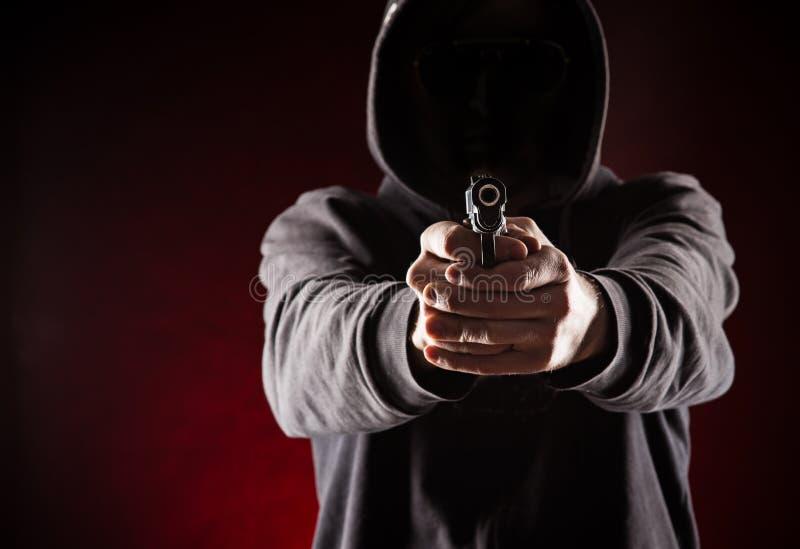 Uccisore con la pistola fotografie stock