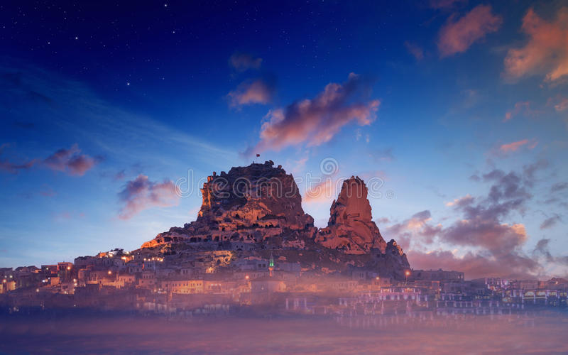 Uchisar castle on rock in ancient town, Cappadocia, Turkey royalty free stock photo
