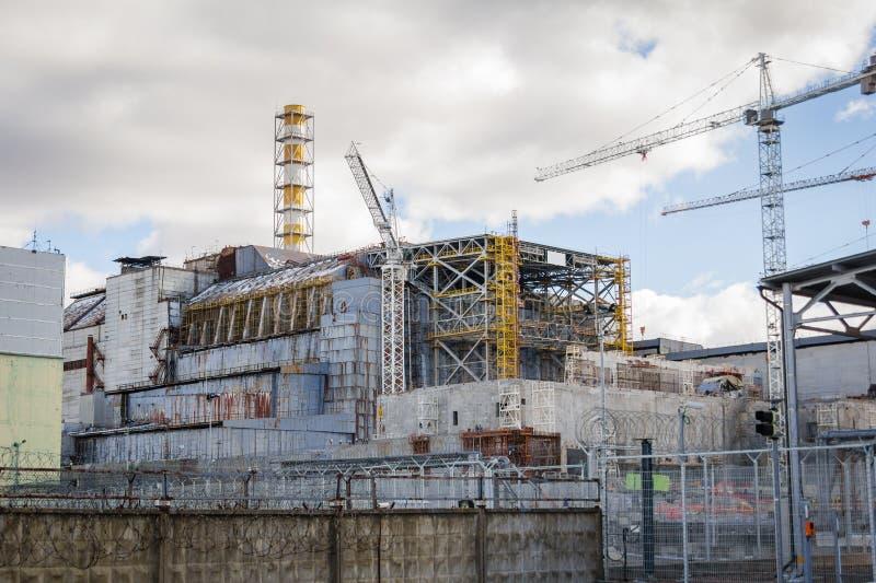 ucrania Zona de exclusión de Chernóbil - 2016 03 19 Vista delantera de la central nuclear foto de archivo libre de regalías