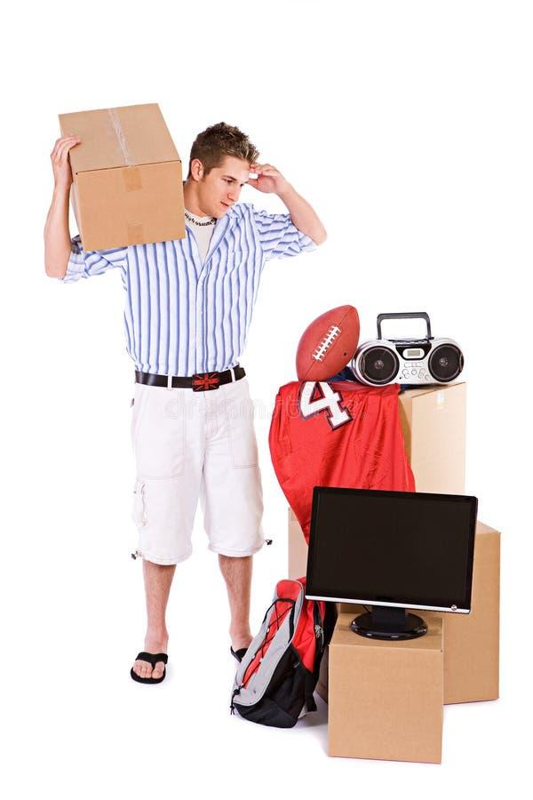 Uczeń: Facet Potrzebuje pomocy Poruszającego Dorm Izbowego materiał obrazy stock