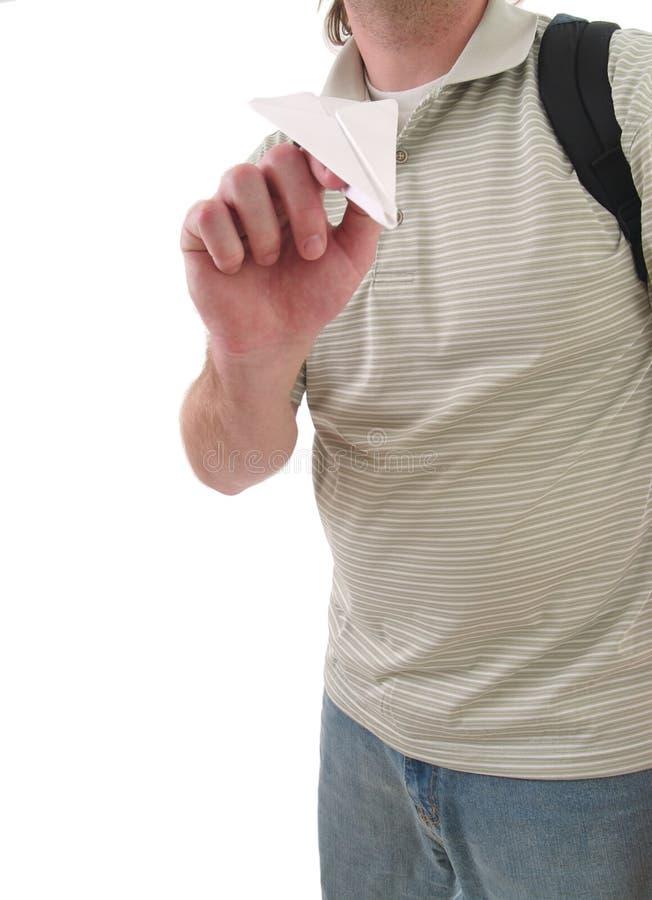 Uczeń z papierowym samolotem zdjęcie royalty free