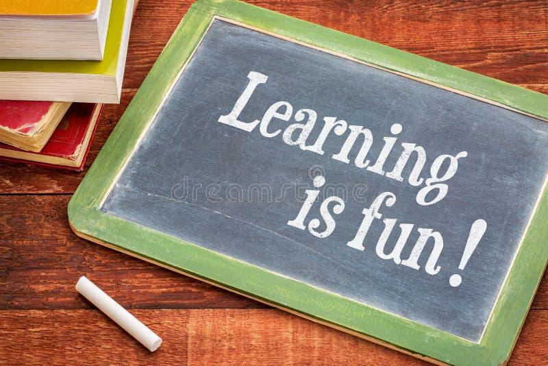 Uczenie jest zabawą - blackboard obrazy royalty free