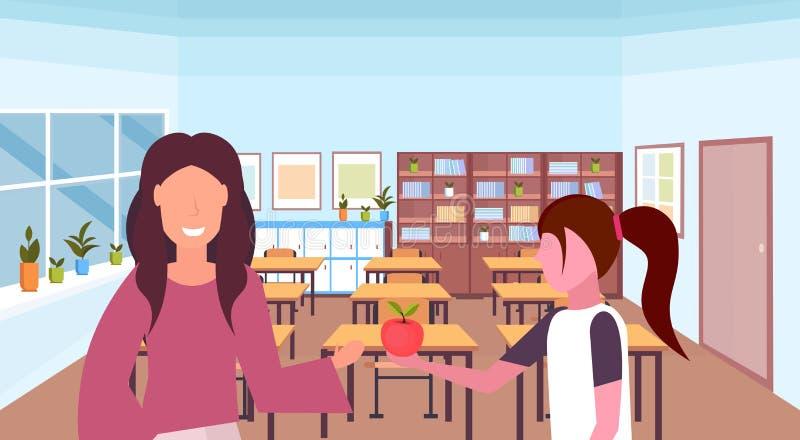Uczennica daje jabłka kobieta nauczyciela edukacji pojęcia nowożytnej szkolnej sali lekcyjnej żeńskich charakterów wewnętrzny por ilustracji