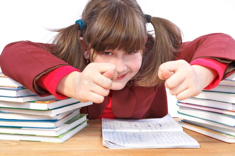Uczennica, schoolwork i sterta książki, fotografia stock