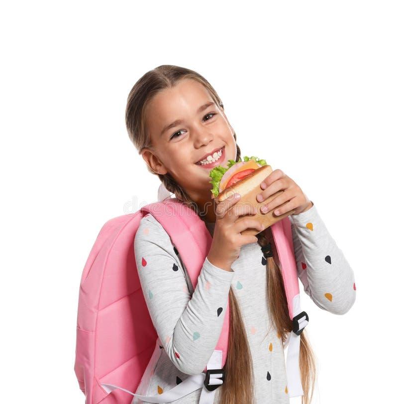 Uczennica z zdrowym jedzeniem i plecakiem fotografia royalty free