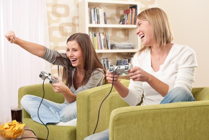 ucznia żeński gemowy bawić się nastolatek tv dwa obrazy stock