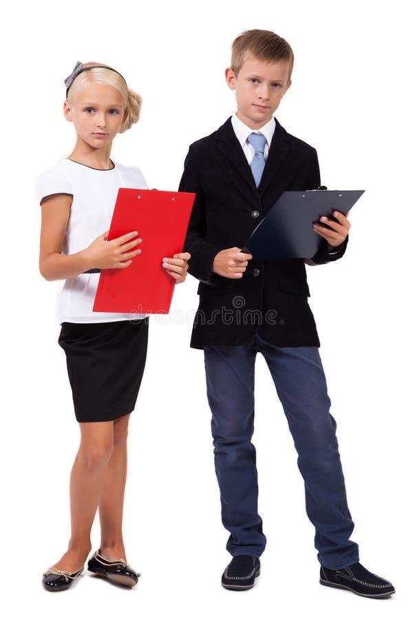 Ucznie dyskutuje gwiazdę w garniturach na białym tle zdjęcia stock