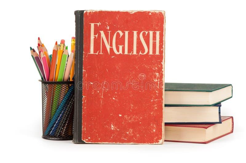 Uczy się angielskiego pojęcie książki uczą kogoś dostawy zdjęcia royalty free