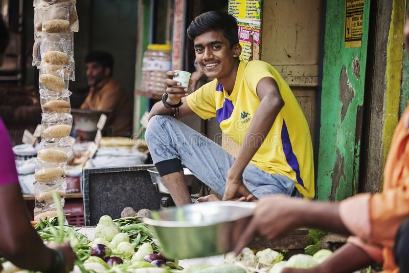 Indian vegetable outdoor street market seller. Udaipur city in Rajasthan, India, January 2018: Indian vegetable outdoor street market seller stock photo