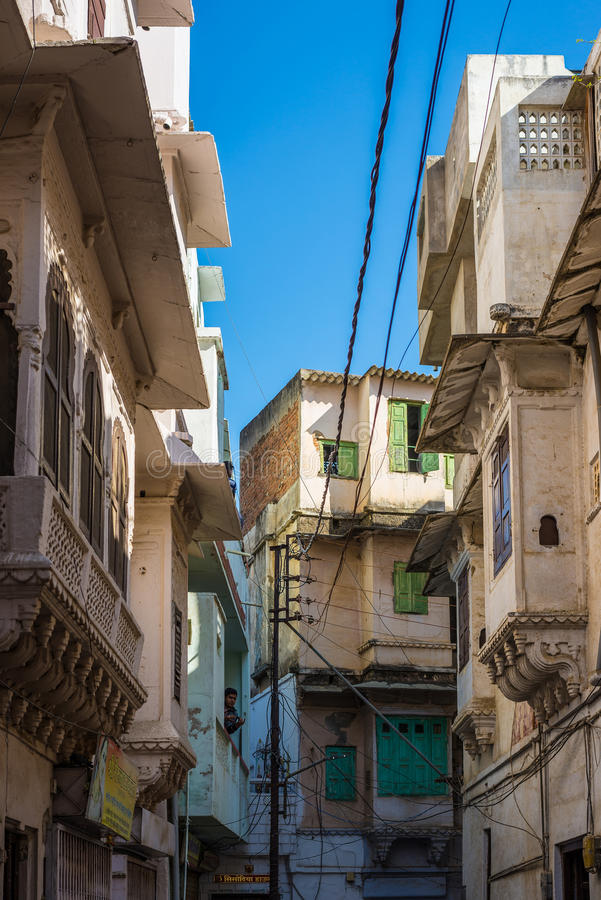 Udaipur, India - January 29, 2017: Walking in the enchanting narrow alleys and streets at Udaipur, famous travel destination in Ra stock photography