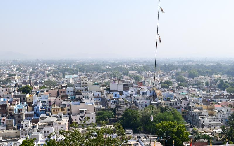 Udaipur, Rajasthan, India May 2019 - The beautiful panoramic landscape Aerial view of Udaipur City skyline. Lots of buildings can. Be seen in distant stock images