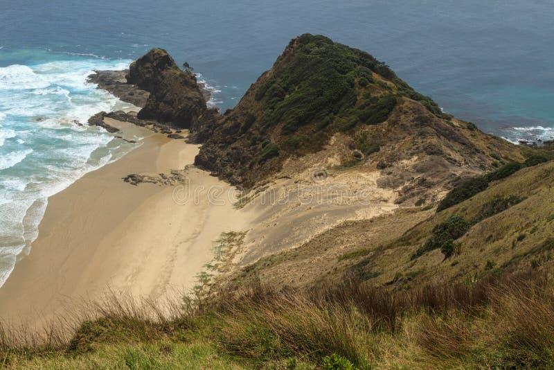 Udde Reinga eller Te Rerenga Wairua i den avlägsna norden av Nya Zeeland royaltyfria bilder