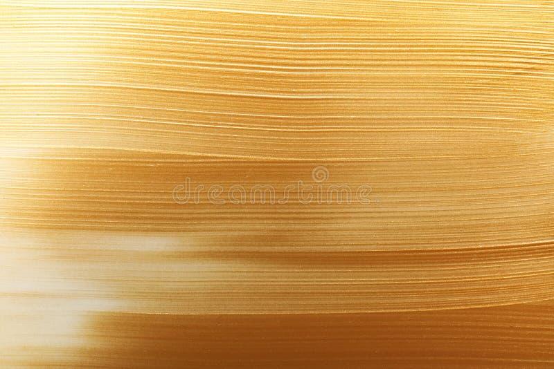 Uderzenia złocista farba jako tło zdjęcia stock