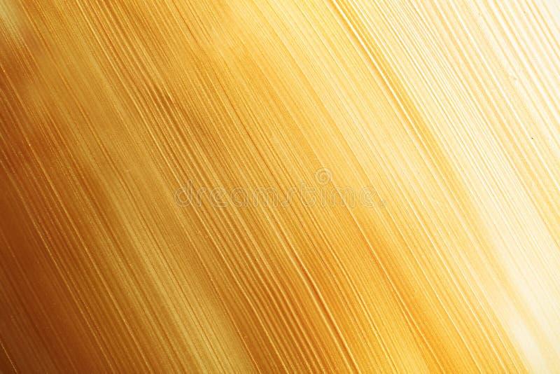 Uderzenia złocista farba jako tło fotografia royalty free