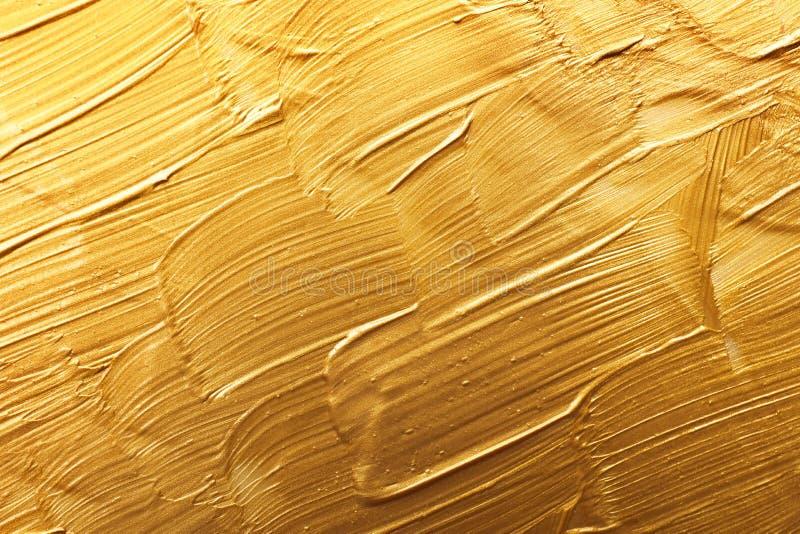 Uderzenia złocista farba jako tło obrazy royalty free