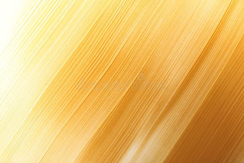 Uderzenia złocista farba jako tło zdjęcia royalty free