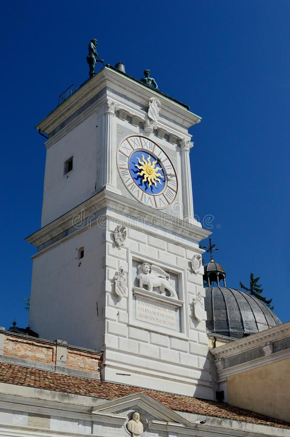 The clock tower View from Piazza della Liberta, Udine, Italy. Udine Castle, Loggia di San Giovanni, Clock tower with 2 moorish figures striking the hour plus stock image