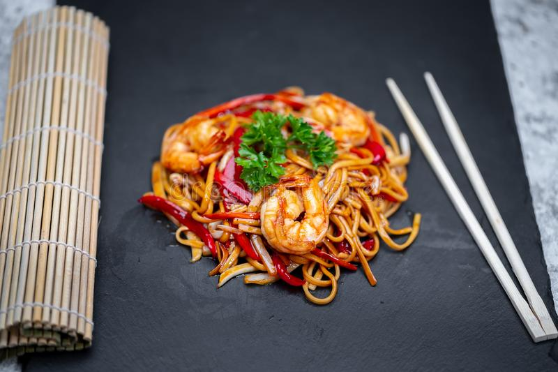 Udon with seafood, japanese cuisine. Yaki udon with seafood, japanese cuisine. spaghetti and shrimp royalty free stock photography