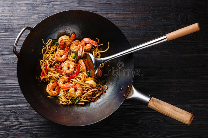 Udon stir-fry noodles with shrimp and vegetables royalty free stock images