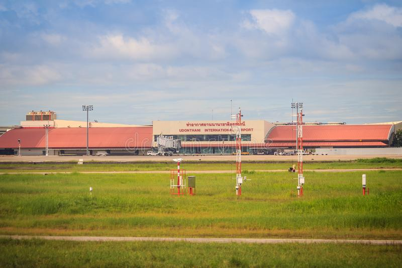 Terminal building on grass field of Udon Thani International Airport (UTH), located near the city of Udon Thani Province in the no royalty free stock images