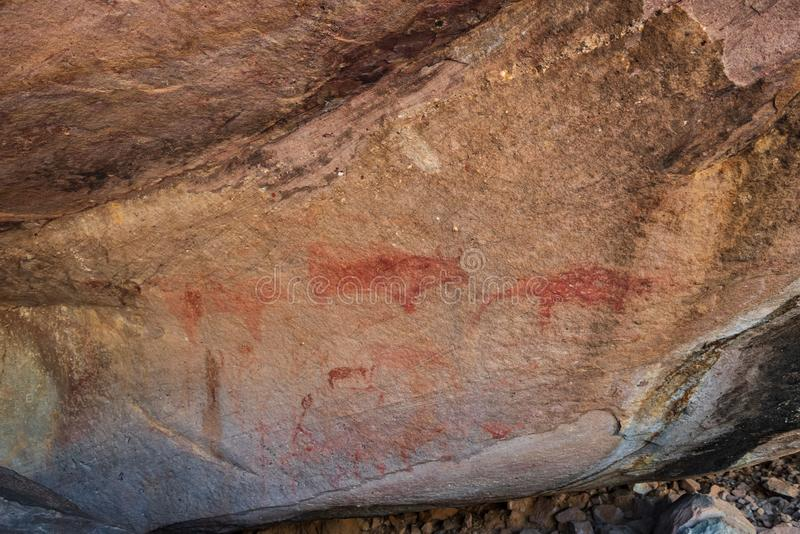 Udon Thani, Thailand - February 23, 2017 : Prehistoric art paintings on the rocks have formed a natural shelter in Phu Phra Bat. The park`s rock paintings are stock image