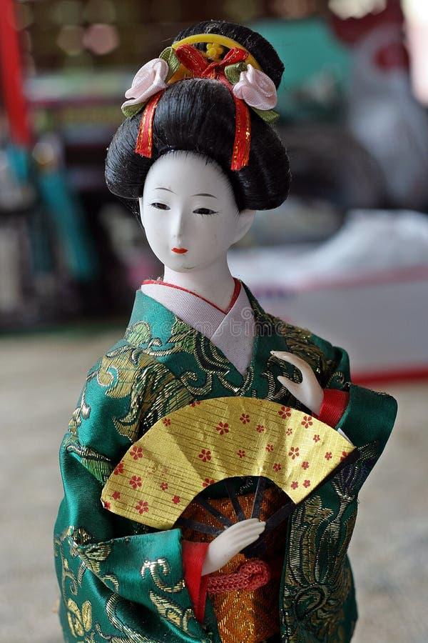Japanese doll in KIMONO dress. royalty free stock photos