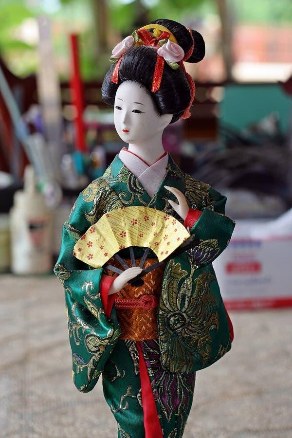 Japanese doll in KIMONO dress. royalty free stock photography