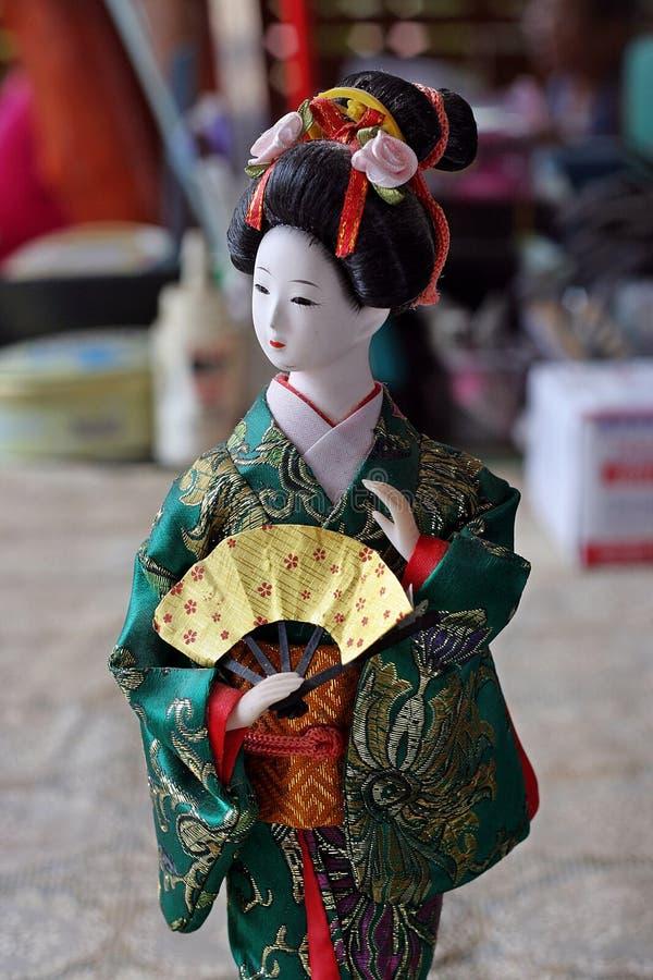 Japanese doll in KIMONO dress. stock photos