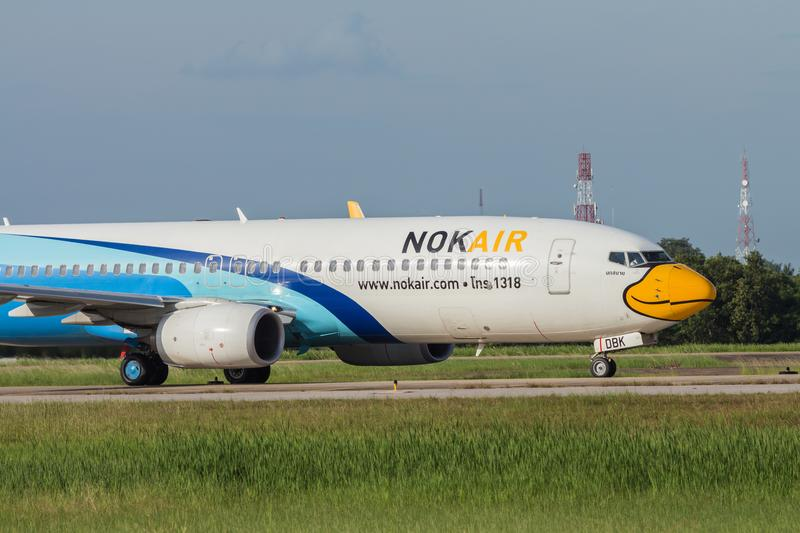 UDONTHANI, THAILAND - AUGUST 14, 2015:Air plane HS-DBK Boeing 737-800NG of Nok iar landing at Udonthani International Airport royalty free stock image