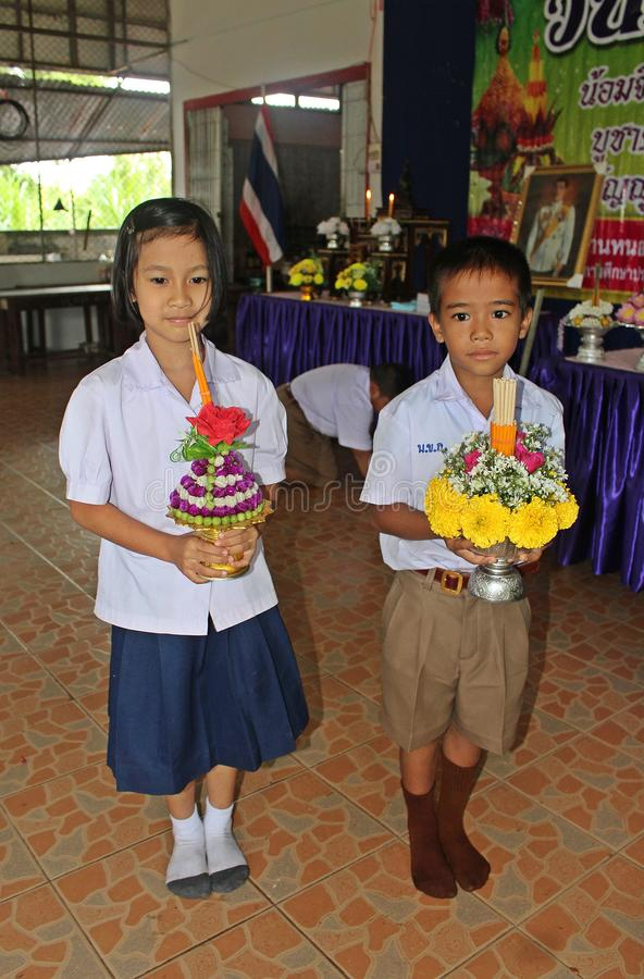 Boy and girl hold flower tray.                 . stock photos