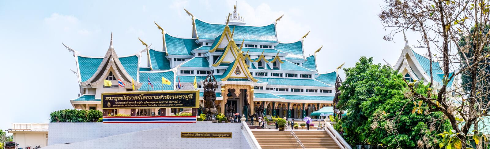 Panorama of famous unique blue roof of Buddhism sacred halls of Wat Pha Phu Gon temple. UDONTHANI, THAILAND - MARCH 17, 2018 : Panorama of famous unique blue royalty free stock photo