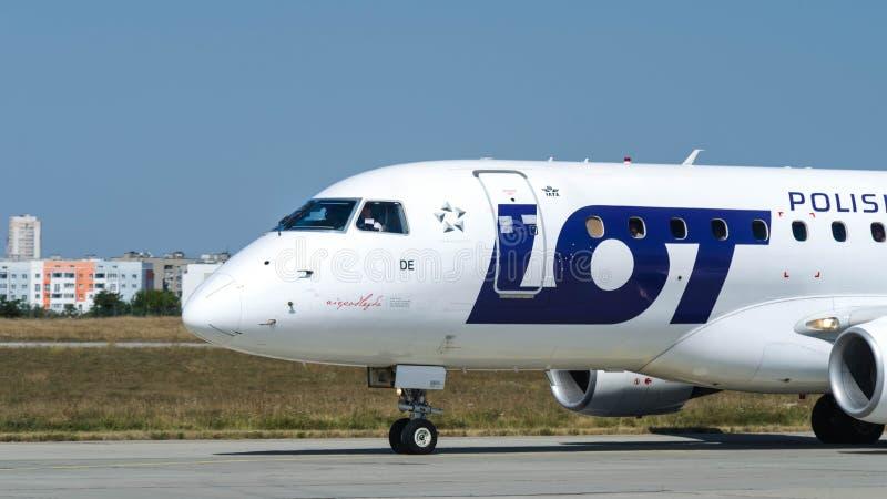 UDZIAŁ Polskie linie lotnicze parkują po lądować przy Kharkiv lotniskiem fotografia royalty free