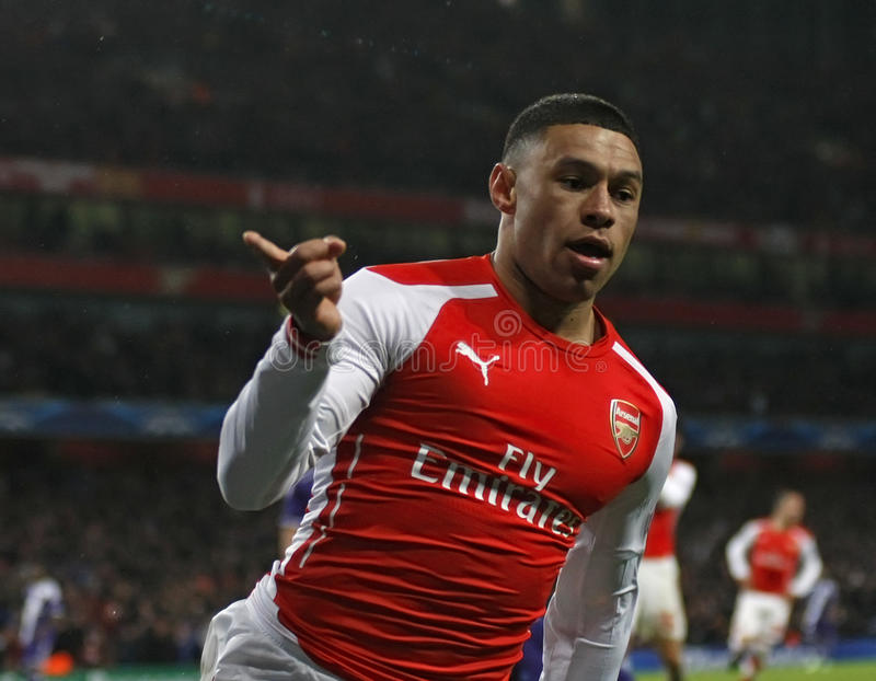 UEFA Champions League Arsenal v Anderlecht. LONDON, ENGLAND - NOV 04 2014: Arsenal's Alex Oxlade-Chamberlain celebrates scoring a goal during the UEFA Champions royalty free stock images