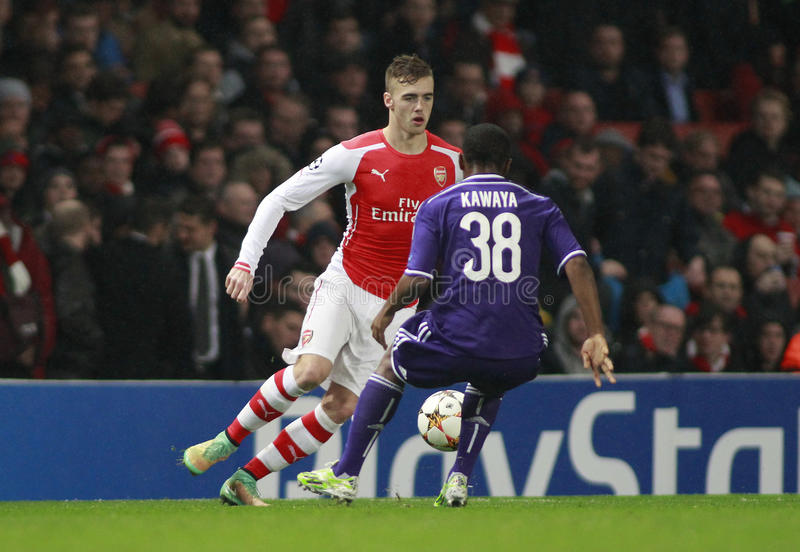 UEFA Champions League Arsenal v Anderlecht. LONDON, ENGLAND - NOV 04 2014: Arsenal's Calum Chambers and Andy Kawaya of Anderlecht during the UEFA Champions royalty free stock images