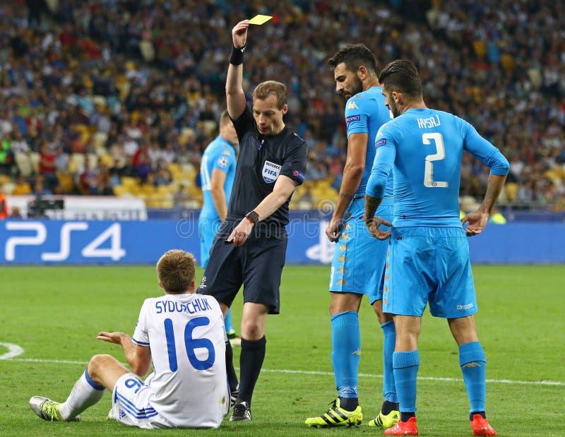 UEFA Champions League game FC Dynamo Kyiv vs Napoli. KYIV, UKRAINE - SEPTEMBER 13, 2016: Referee William Collum shows yellow card to Serhiy Sydorchuk of Dynamo stock photo